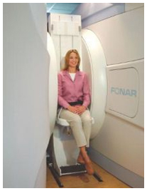 Woman Sitting in Vertical MRI Machine